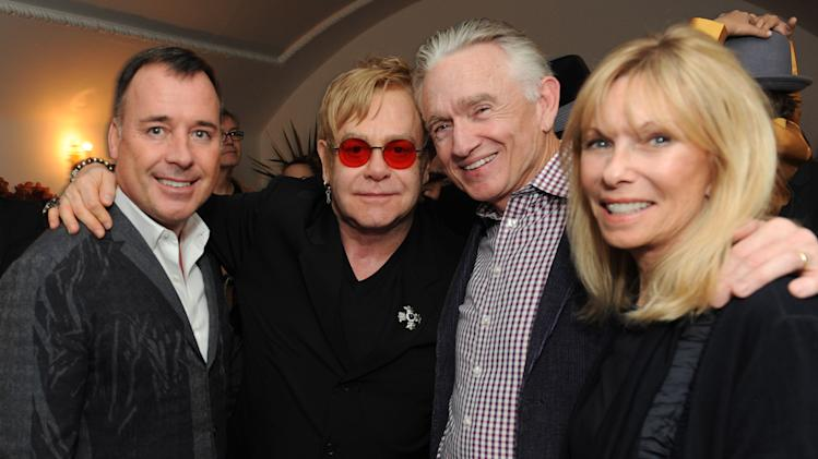 "From left, David Furnish, Elton John, Ian Telfer and Nancy Burke attend LoveGold/EJAF Celebrate ""How to Survive a Plague"" at Chateau Marmont on February 22, 2013 in Los Angeles. (Photo by Jordan Strauss/Invision for LoveGold/AP Images)"