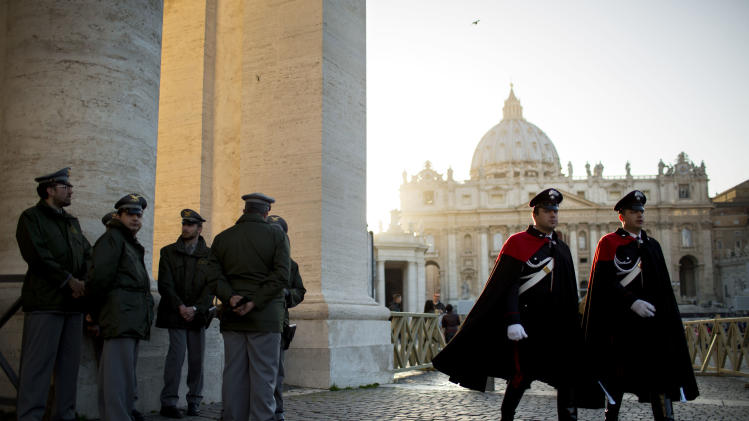 Security guards patrol in St. Peter's Square at the Vatican, Monday, March 18, 2013. a day before the inaugural Mass of Pope Francis.  The Vatican released details of the pope's installation Mass on Tuesday as well images of his coat of arms and fisherman's ring. In addition to more than 132 government delegations, the Vatican said 33 Christian delegations will be present, as well as representatives from Jewish, Muslim, Buddhist, Sikh and Jain communities. (AP Photo/Oded Balilty)