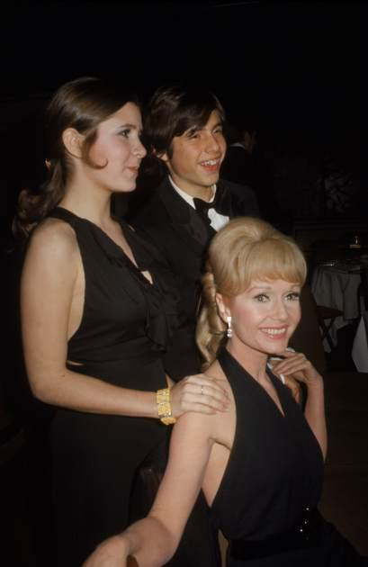 Carrie Fisher stands with her mother. Debbie Reynolds, and her brother Todd Fisher at the premiere party for their new play 'Irene,' at Raffles, New York, March 13, 1973 -- Getty Images