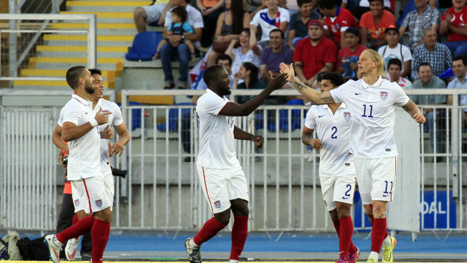 U.S. player Brek Shea, right, celebrates with teammates after scoring against Chile during their friendly soccer match in Rancagua, Chile, Wednesday, Jan. 28, 2015. (AP Photo/Luis Hidalgo)