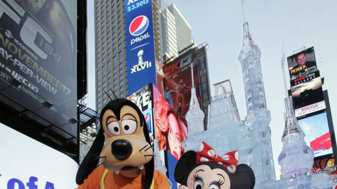 """Disney characters Goofy and Minnie Mouse pose in front of a three-story castle made of ice in New York's Times Square,  Wednesday, Oct. 17, 2012. On Wednesday, Disney announced a new program for 2013, """"Limited Time Magic,"""" in which guests will encounter surprise weekly themes at Disney parks in Florida and California.  The program was described as """"52 weeks of magical experiences big and small that appear, then disappear as the next special surprise debuts."""" For example, a weeklong Valentine's Day celebration might include pink lighting on Disney castles, surprise meet-and-greets with Disney characters and candlelit dinners for lovebirds. (AP Photo/Richard Drew)"""