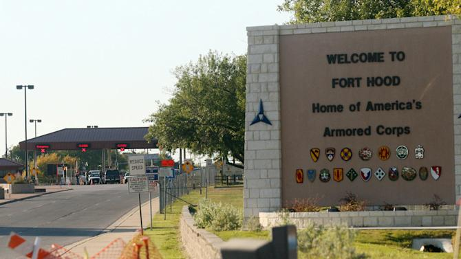 FILE- In this Nov. 5, 2009, file photo, an entrance to Fort Hood Army Base in Fort Hood, Texas, near Killeen remains in lock-down following a mass shooting. Osama bin Laden is dead and there hasn't been a successful attack by al-Qaida-inspired extremists on U.S. soil since the deadly shooting rampage in Fort Hood, Texas, in 2009. But the danger of terrorism remains a reality for Americans, as seen in the attack in Libya in September that killed U.S. Ambassador Chris Stevens and three other Americans. (AP Photo/Jack Plunkett)