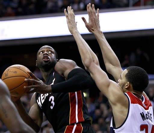 Wade's 26 is quite a show; Heat top Wizards 106-89