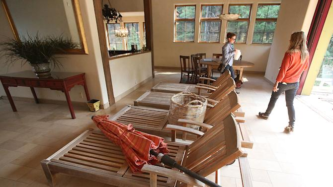 Heidi Baldwin, right, and her daughter DeSiree moved her lawn furniture inside their house while clearing items around her home, to ease the movement of firefighters, if the Beaver Creek Fire hits on Sunday, Aug. 18, 2013 outside of Ketchum, Idaho. AP Photo/Times-News, Ashley Smith) Mandatory Photo Credit