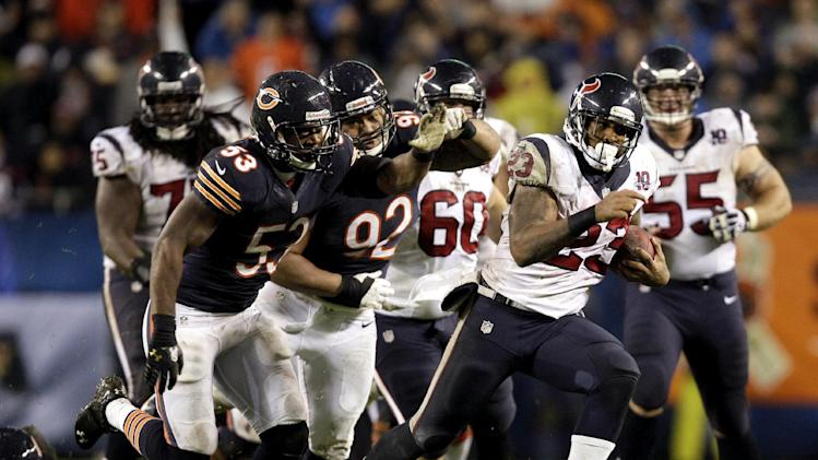 Houston Texans running back Arian Foster (23) rushes past Chicago Bears linebacker Nick Roach (53) and defensive tackle Stephen Paea (92) during the first half an NFL football game, Sunday, Nov. 11, 2012, in Chicago. (AP Photo/Nam Y. Huh)