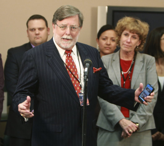 Cheney Mason answers questions after his client, Casey Anthony, was found not guilty in her murder trial in Orlando, Fla., Tuesday, July 5, 2011. Anthony had been charged with killing her daughter, Caylee. (AP Photo/Joe Burbank, Pool)