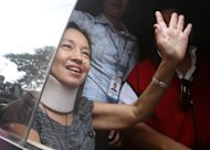 Former president Gloria Macapagal-Arroyo waves to media and supporters after her bail petition's approval. (NPPA Images)