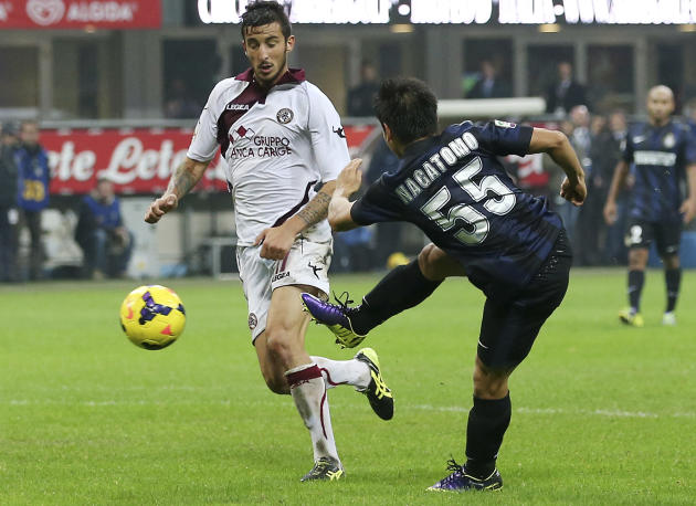 Inter Milan defender Yuto Nagatomo, of Japan, scores a goal during the Serie A soccer match between Inter Milan and Livorno at the San Siro stadium in Milan, Italy, Saturday, Nov. 9, 2013