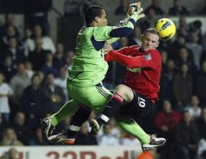 Swansea City's Vorm challenges Manchester United's Rooney during their English Premier League soccer match at the Liberty Stadium in Swansea