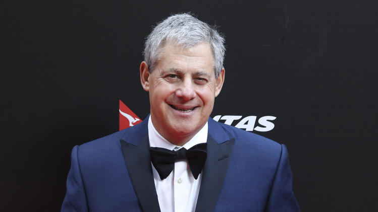 "FILE - This Dec. 21, 2012 file photo shows Cameron Mackintosh, producer of the stage production of ""Les Miserables"" in Sydney, Australia for the premiere of the film version. Mackintosh is in New York working on a new version of ""Les Miserables"" that opens on Broadway this month. Mackintosh, the producer behind such mega-hits as ""Cats,"" ""The Phantom of the Opera"" and ""Miss Saigon, "" keeps finding himself in the strange position of returning to former triumphs, stripping them down and then building them up again. ""Les Miserables"" opens on March 23. (AP Photo/Rob Griffith, File)"