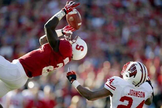 Stanford wide receiver Jamal-Rashad Patterson, left, makes a catch against Wisconsin defensive back Shelton Johnson (24) during the first half of the Rose Bowl NCAA college football game, Tuesday, Jan