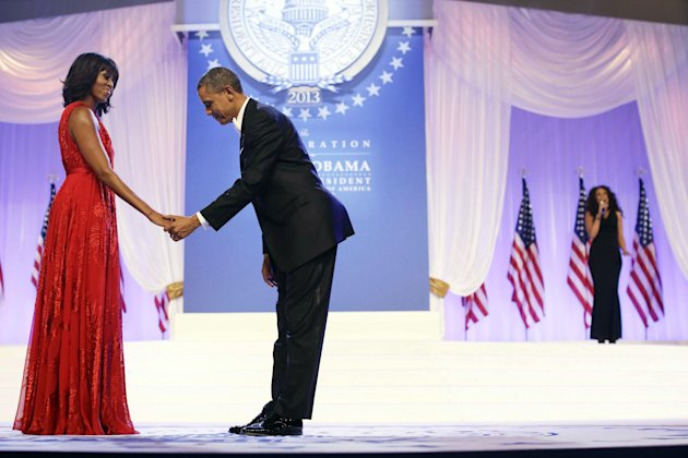 "President Barack Obama bows as he and first lady Michelle Obama, wearing a ruby colored chiffon and velvet Jason Wu gown, gets ready to dance as singer Jennifer Hudson, right, sings Al Green's ""Let's Stay Together"" at the Inaugural Ball at the Washington Convention Center during the 57th Presidential Inauguration in Washington, Monday, Jan. 21, 2013. (AP Photo/Charles Dharapak)"