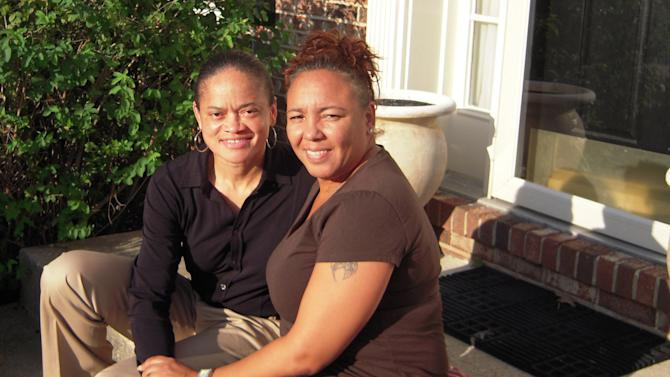 In this Oct. 4, 2012 photo, Irene Huskens, right, and her partner, Leia Burks, sit on the front porch of their home in Bowie, Md. Huskens has the wedding venue picked out: a charming bed-and-breakfast in southern Maryland. But the wedding is no sure thing. Their plans hinge on whether Marylanders make history on Nov. 6, 2012 by voting to legalize same-sex marriage. (AP Photo/David Crary)