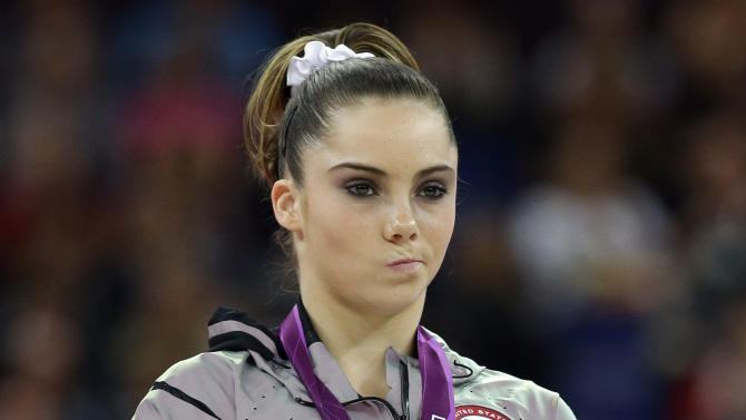FILE - In this Aug. 5, 2012 file photo, silver medallist McKayla Maroney, of the United States, stands during the podium ceremony for the artistic gymnastics women's vault finals at the 2012 Summer Olympics in London. Maroney's unimpressed reaction following her performance let the world know, in a moment that became one of the sports photos of the year and the sports-meme-generator of the year, that she wasn't exactly thrilled over not doing enough to take the gold. (AP Photo/Julie Jacobson, File)
