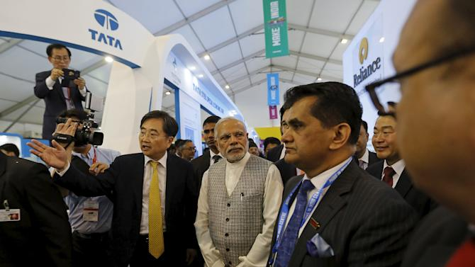 India's Prime Minister Narendra Modi visits a pavilion at the exhibition centre of the 'Make In India' week in Mumbai