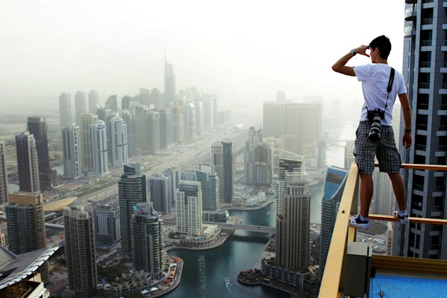 Russian student Marat Dupri scales huge skyscrapes with his friends to capture vertigo-inducing pictures (Caters)
