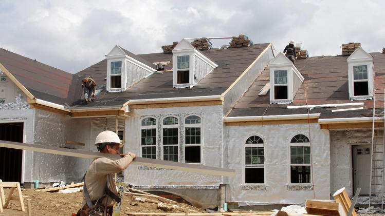 This May 2, 2012, photo, shows a new homes under construction in Bridgeville, Pa. A surge in homebuilding pushed U.S. construction spending up by the largest amount in five months, the latest indication that the housing sector is slowly recovering. Construction spending rose 0.9 percent in May, following a 0.6 percent rise in April, the Commerce Department reported Monday, July 2, 2012. It was the biggest percentage gain since December.  (AP Photo/Gene J. Puskar)