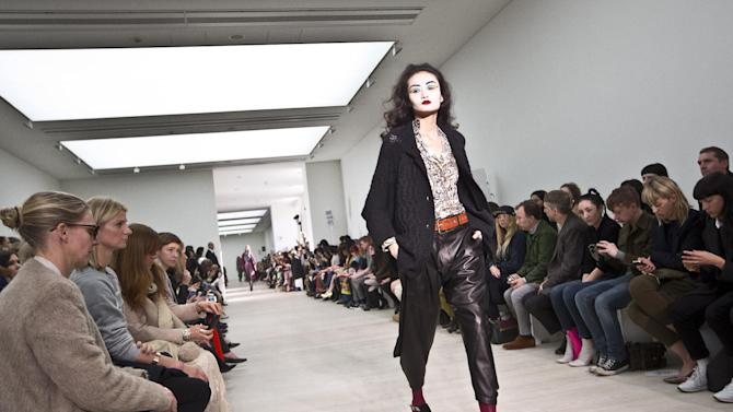 A model wears a design created by Vivienne Westwood during London Fashion Week, at the Saatchi Gallery in West London, Sunday, Feb. 17, 2013. (Photo by Joel Ryan/Invision/AP)