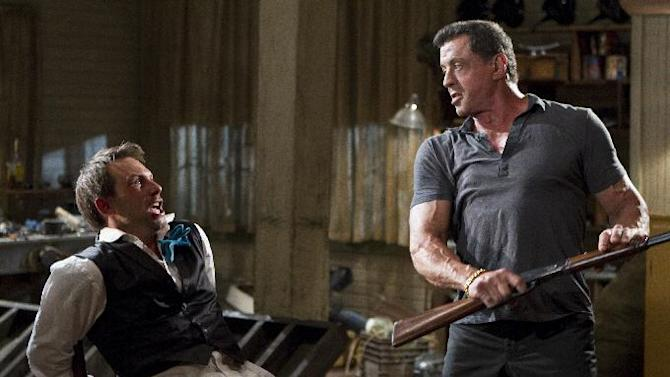 """This film image released by Warner Bros. Pictures shows Christian Slater, left, and Sylvester Stallone in a scene from """"Bullet to the Head."""" (AP Photo/Warner Bros. Pictures, Frank Masi)"""