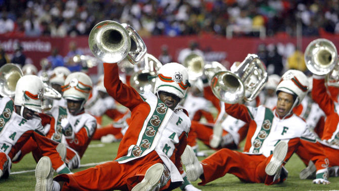 FILE - In this Sept. 26, 2009 file photo, the Florida A&M marching band members performs during the half time show of the 2009 Atlanta Football Classic NCAA college football game between FAMU and Tennessee State at the Georgia Dome in Atlanta. Robert Champion, a Florida A&M drum major who died after being hazed on a bus, asked to go through the ordeal because it was seen as an honor, said Jonathan Boyce, a defendant  in the case, in a deposition released Wednesday, May 23, 2012. Champions' parents have said their son was a vocal opponent of the routine hazing in the band. (AP Photo/The Atlanta Journal & Constitution, Jason Getz, File) MARIETTA DAILY OUT, GWINNETT DAILY POST OUT