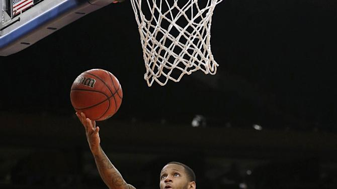 Baylor's Pierre Jackson drives to the basket during the first half of the NIT championship basketball game against Iowa, Thursday, April 4, 2013, in New York. (AP Photo/Frank Franklin II)