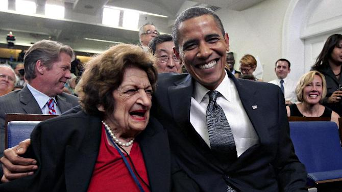 FILE - In this Aug. 4, 2009, file photo, veteran White House reporter Helen Thomas, left, celebrates her 89th birthday with President Barack Obama, celebrating his 48th birthday, in the White House Press Briefing Room in Washington. Thomas, a pioneer for women in journalism and an irrepressible White House correspondent, has died Saturday, July 20, 2013. She was 92. (AP Photo/J. Scott Applewhite, File)