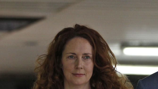 Former News International chief executive Rebekah Brooks, leaves after appearing at Southwark Crown court on charges relating to the phone hacking scandal, in London, Friday, June 22, 2012. (AP Photo/Lefteris Pitarakis)