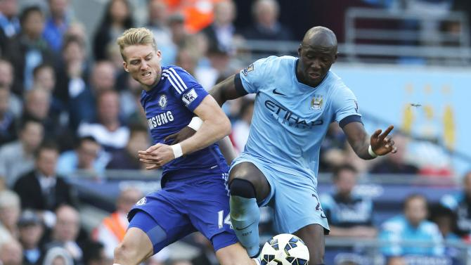 Chelsea's Schurrle challenges Manchester City's Mangala during their English Premier League soccer match at the Etihad stadium in Manchester