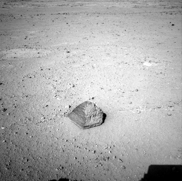 This Wednesday, Sept. 19, 2012 photo provided by NASA shows a rock about 8 feet (2.5 meters) in front of the Curiosity rover on Mars. The rock is about 10 inches (25 centimeters) tall and 16 inches (4