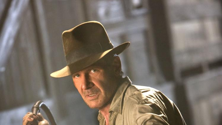 "FILE - In this file image originally released by Paramount Pictures, Harrison Ford is shown in a scene from the summer blockbuster film, ""Indiana Jones and the Kingdom of the Crystal Skull.""  (AP Photo/Paramount Pictures, David James, file)"