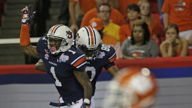 Auburn wide receiver Emory Blake (80) celebrates with wide receiver Trovon Reed (1) after Blake scored a touchdown in the first quarter of a NCAA college football game against Clemson at the Georgia Dome in Atlanta Saturday, Sept. 1, 2012. (AP Photo/Dave Martin)