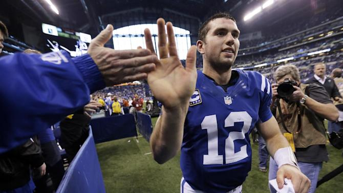 Indianapolis Colts' Andrew Luck (12) is congratulated by a fan as he leaves the field after the Colts defeated the Houston Texans, 28-16, in an NFL football game, Sunday, Dec. 30, 2012, in Indianapolis. (AP Photo/AJ Mast)