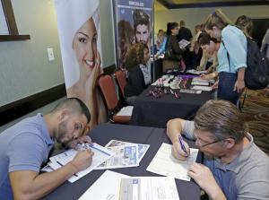 In this Wednesday, Oct. 22, 2014 photo, job seekers …