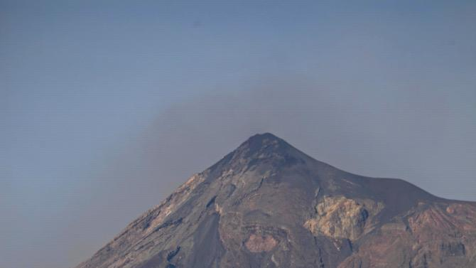 The Volcan de Fuego or Volcano of Fire releases a puff of volcanic ash as seen from Antigua Guatemala, Friday, Sept. 14, 2012. The volcano spewed rivers of bright orange lava down its flanks on Thursday. Authorities ordered more than 33,000 people from nearby communities evacuated. (AP Photo/Moises Castillo)