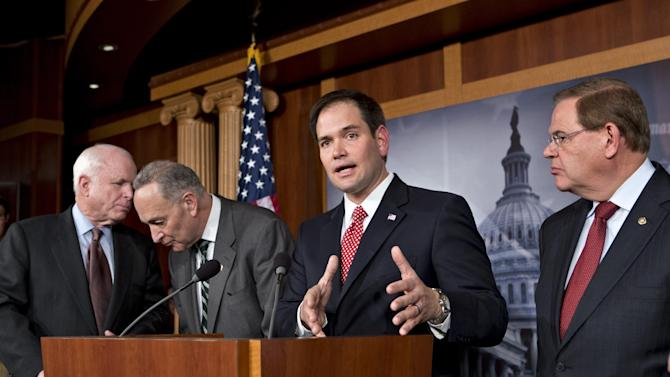 """FILE – In this Jan. 28, 2013, file photo Sen. Marco Rubio, R-Fla., center, speaks at a Capitol Hill news conference on immigration legislation with a members of a bipartisan group of leading senators, including, from left, Sen. John McCain, R-Ariz., Sen. Chuck Schumer, D-N.Y. and Sen. Robert Menendez, D-N.J., in Washington. After months of arduous closed-door negotiations, the """"Gang of Eight"""" senators equally divided between the two parties had no issues left to resolve in person, and no more negotiating sessions were planned. Remaining details were left to aides, who were at work completing drafts of the bill. (AP Photo/J. Scott Applewhite, File)"""