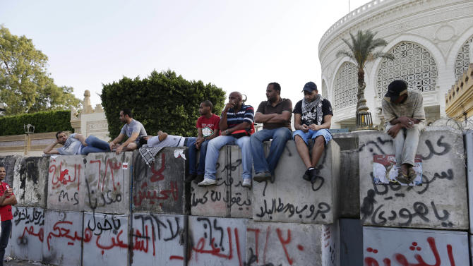 "Opponents of Egypt's Islamist President Mohammed Morsi protest outside the presidential palace in Cairo, Egypt, Monday, July 1, 2013. Hundreds of thousands thronged the streets of Cairo and cities around the country Sunday and marched on the presidential palace, filling a broad avenue for blocks, in an attempt to force out the Islamist president with the most massive protests Egypt has seen in 2½ years of turmoil. Arabic reads: ""Revolution continues, June 30, victory."" (AP Photo/Hassan Ammar)"