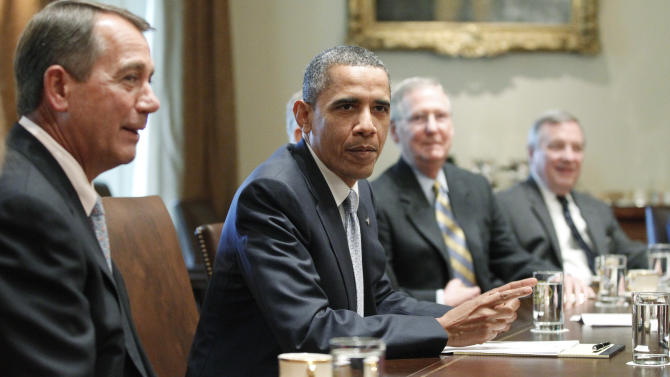 President Barack Obama sits with House Speaker John Boehner of Ohio, and Senate Minority Leader Mitch McConnell of Kentucky, and Sen. Dick Durbin, D-Ill., as he meets with Republican and Democratic leaders regarding the debt ceiling in the Cabinet Room of the White House in Washington, Wednesday, July 13, 2011. (AP Photo/Charles Dharapak)