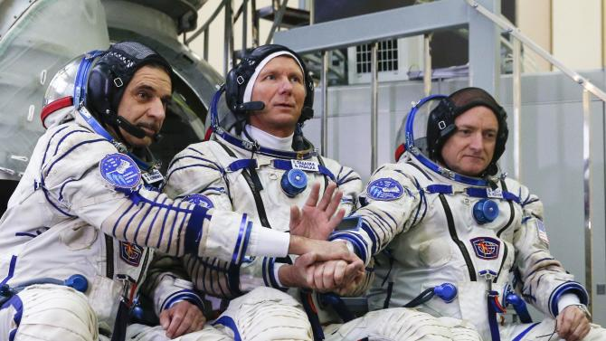 Russian cosmonauts Mikhail Korniyenko, Gennady Padalka and NASA astronaut Scott Kelly pose before a crew's training session at training centre in Star City