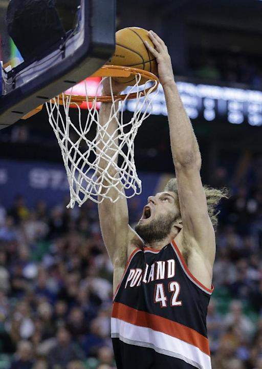 Portland Trail Blazers' Robin Lopez dunks the ball in the second half during an NBA basketball game against the Utah Jazz, Monday, Dec. 9, 2013, in Salt Lake City.  The Trail Blazers won 105-94