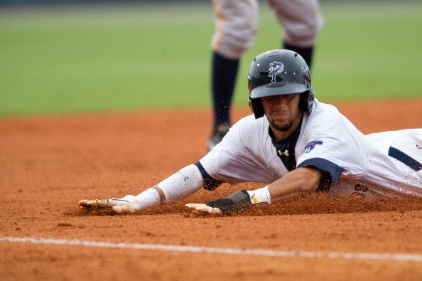 Billy Hamilton #4 of the Pensacola Blue Wahoos slides safely into third base as against the Montgomery Biscuits at Community Maritime Park Stadium on August 19, 2012 in Pensacola, Florida. Billy Hamil