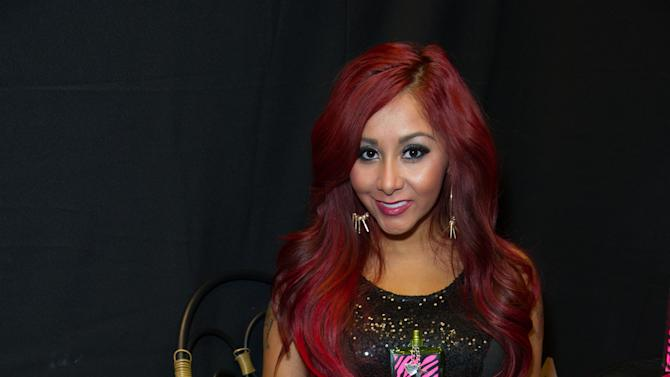 """Nicole """"Snooki"""" Polizzi poses for a photo before a meet and greet at a Perfumania for the release of her second fragrance, """"Snooki Couture"""" on Wednesday, January 9, 2013, in Las Vegas, NV (Photo by Al Powers/Powers Imagery/Invision/AP)"""