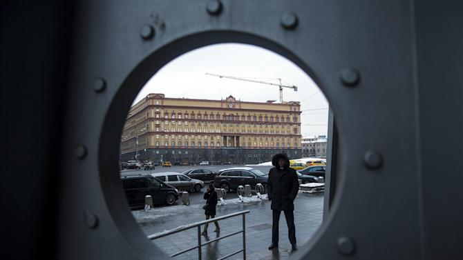 A security man stands in Lubyanka Square, with the main building of the Russian Federal Security Service, former KGB headquarters, in the background, in Moscow, Russia, Tuesday, Jan. 27, 2015. A long-awaited inquiry into the death of former Russian spy Alexander Litvinenko opened Tuesday in London  with the revelation that the KGB agent turned Kremlin critic may have been poisoned with radioactive polonium not once, as authorities initially thought, but twice. (AP Photo/Pavel Golovkin)
