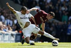 Tottenham Hotspur's Assou-Ekotto challenges Manchester City's Milner during their English Premier League soccer match at White Hart Lane in London