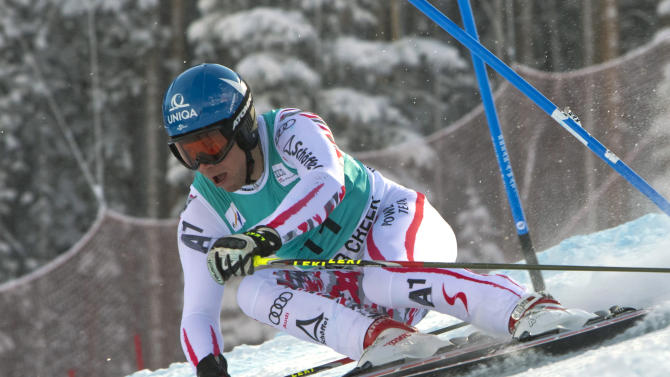Benjamin Raich, of Austria, races down the course during the men's World Cup giant slalom ski competition on Sunday, Dec. 4, 2011, in Beaver Creek, Colo. (AP Photo/Nathan Bilow)