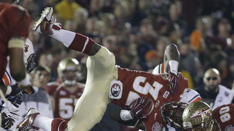 Florida State's James Wilder Jr. is upended during the second half of the NCAA BCS National Championship college football game against Auburn Monday, Jan. 6, 2014, in Pasadena, Calif. (AP Photo/David J. Phillip)