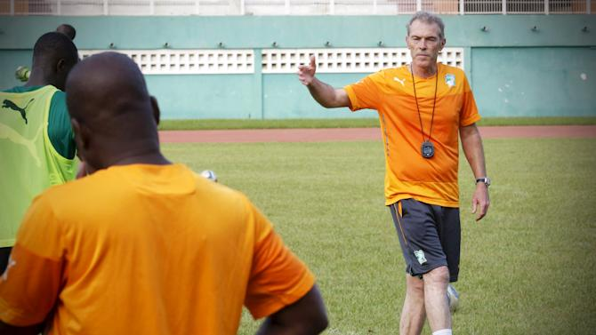 The new soccer coach of African champions, Ivory Coast, Michel Dussuyer (R), speaks during a training session at the Felix Houphouet-Boigny stadium in Abidjan, Ivory Coast