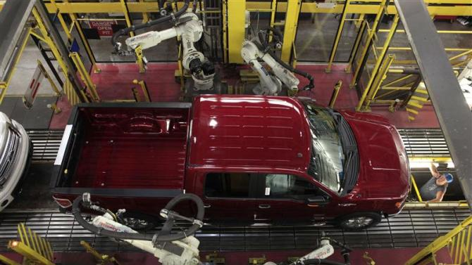 File photo of robots doing a quality control check of a 2014 Ford F-150 pick-up truck as it moves down the assembly line at the Ford Motor Dearborn Truck Plant