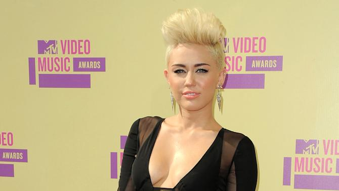 FILE - In this Sept. 6, 2012 file photo, Miley Cyrus attends the MTV Video Music Awards in Los Angeles. A judge granted Cyrus a three-year restraining order on Friday Nov. 16, 2012 against a man convicted of trespassing at the actress-singer's home and resisting arrest.  (Photo by Jordan Strauss/Invision/AP, file)