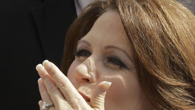 Rep. Michele Bachmann, R-Minn., blows a kiss to a supporter after her formal announcement to seek the 2012 Republican presidential nomination, Monday, June 27, 2011, in Waterloo, Iowa. Bachmann, who was born in Waterloo, will continue her announcement tour this week with stops in New Hampshire and South Carolina. (AP Photo/Charlie Riedel)