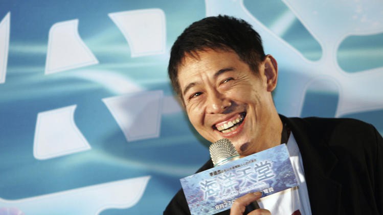 "FILE - In this Monday, Aug. 23, 2010 file photo, Chinese actor Jet Li smiles during a press event for announcing his new movie ""Ocean Heaven,"" in Taipei, Taiwan. Li said he's being treated for an overactive thyroid, but he's determined to fight the condition head-on. (AP Photo/Chiang Ying-ying, File)"